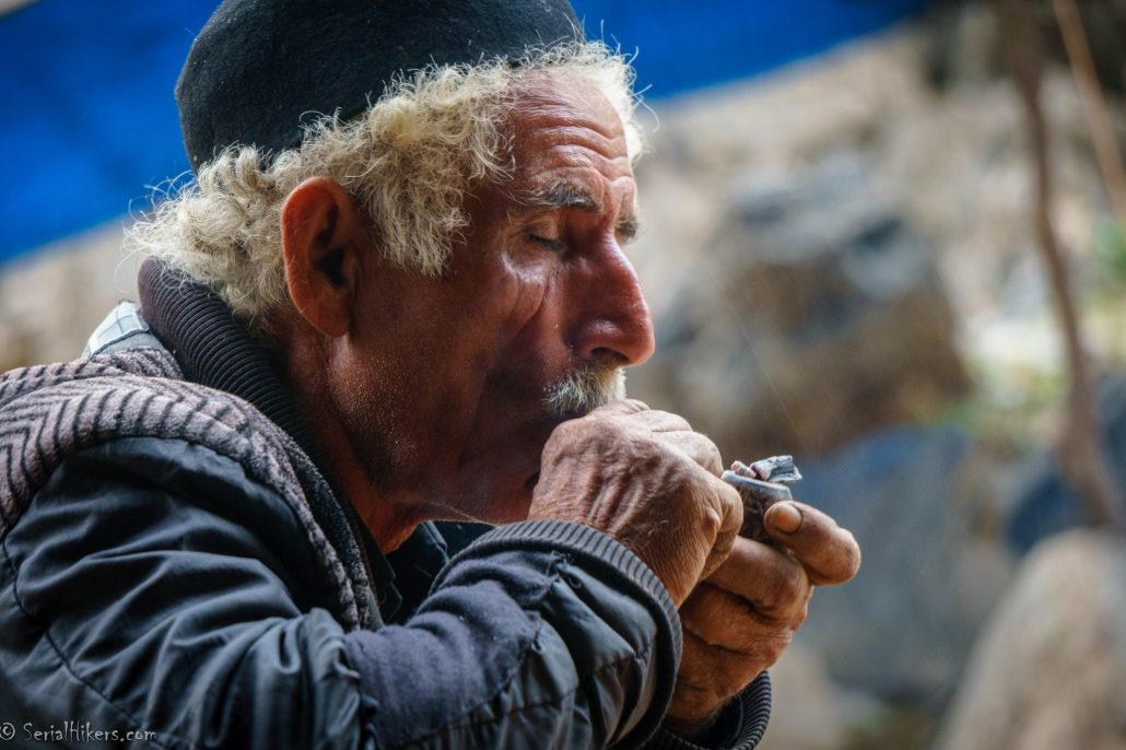 Nomads men in Iran smoking pipe