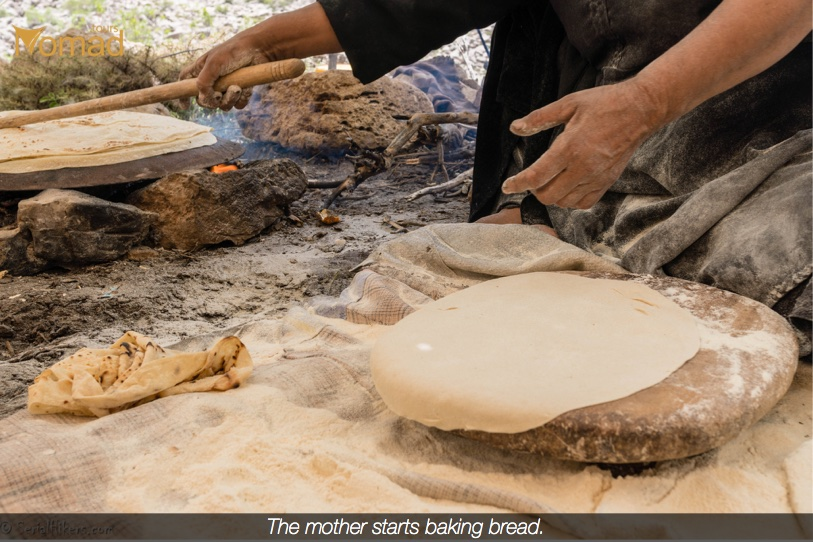 Bakhtiari nomad woman baking bread, in Iran
