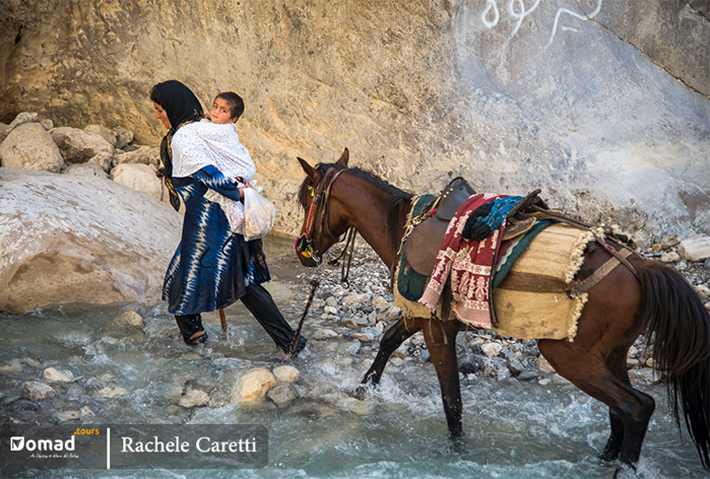 bakhtiari woman crossing river during koch