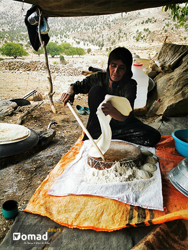 bakhtiari woman making bread