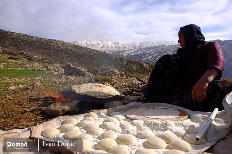iranian bakhtiari woman making bread