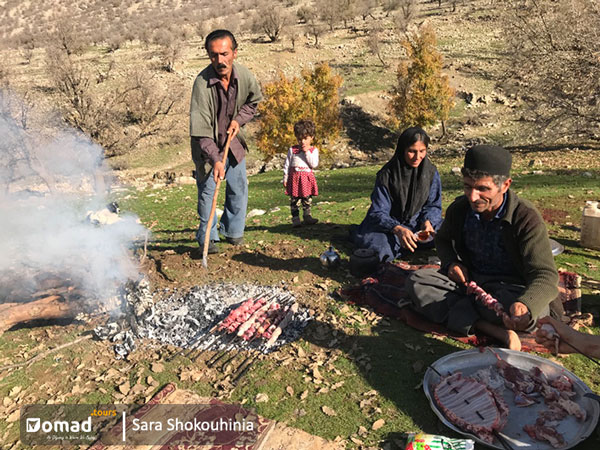 Nomadic people making kebab