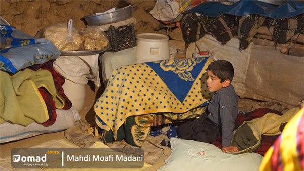 iranian nomadic children in their tent
