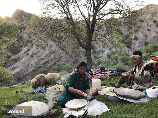 iranian nomadic family making bread