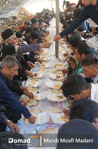 nomadic men eating luxury lunch in wedding