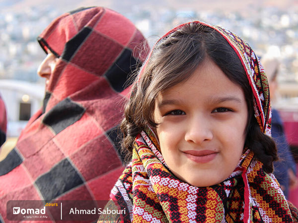 child of sang-e sar nomads with traditional dress
