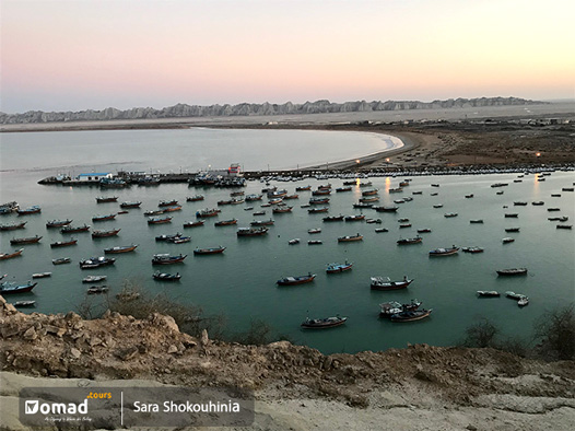 Bris in Iran, a port full of fishing boats in a greenish blue water of Persian gulf