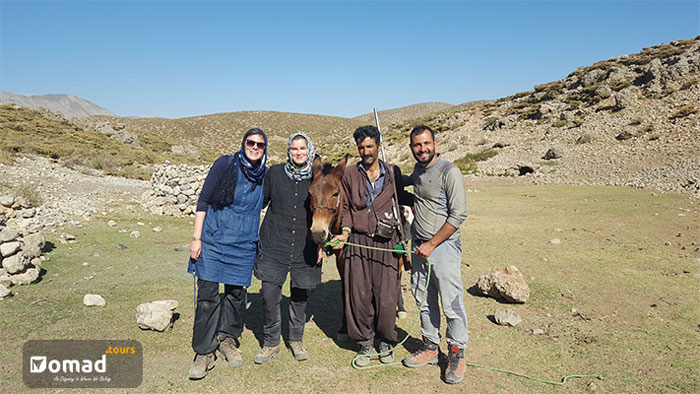 iranian bakhtiari man with travelers in zagros mountain