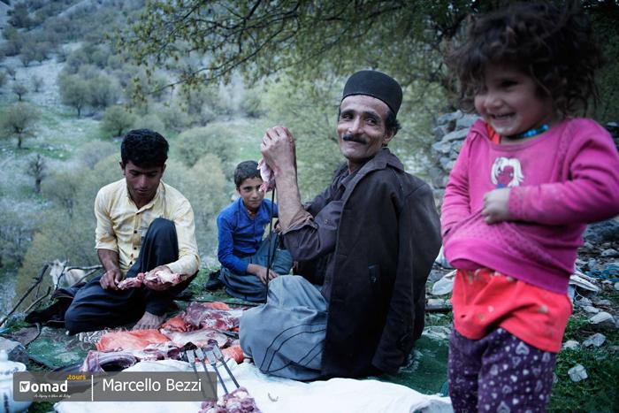 Iraninan nomadic family making kebab