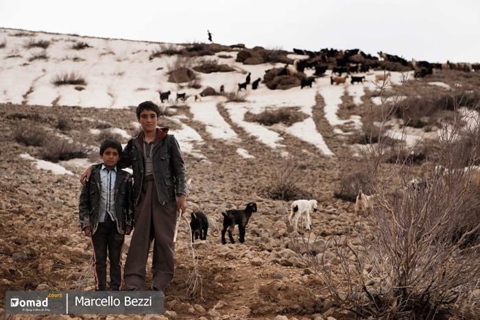 iranian nomadic boy in zagros mountain ranges