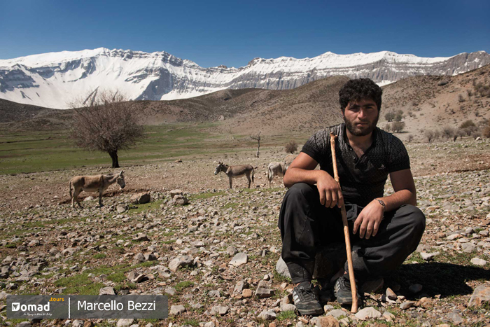 Portrait of the young man in a moment of pause in the Iranian mountains.