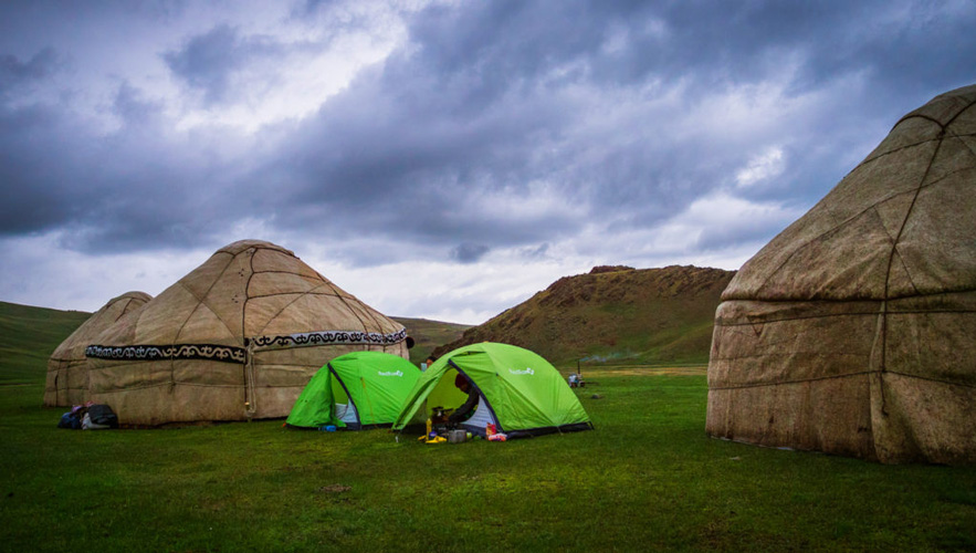 Journal of Nomads' camps beside nomadic yurt camps in Kyrgyzstan in a cloudy weather