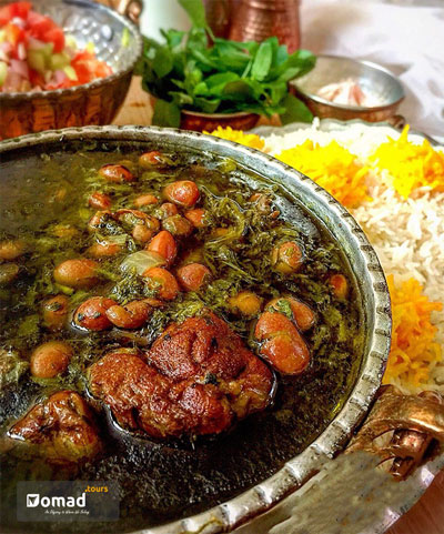 Ghorme sabzi_A Iranian herb stew with lamb & bean, beside a dish of rice and Shirazi salad