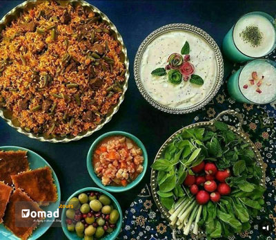 Loobia Polo_An Iranian food with rice & green beans, beside a bowl of olive, pickle, vegetable, tahdig and yogurt