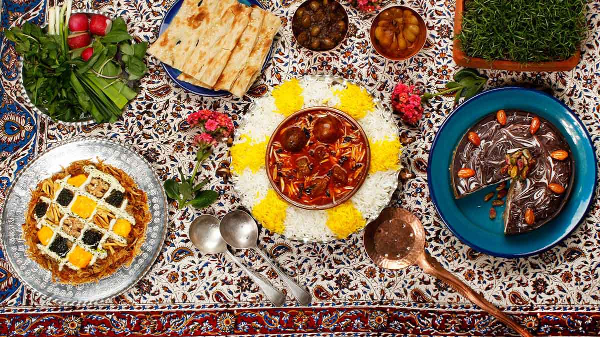Main Persian Foods on a traditional Iranian tablecloth, served by Sangak bread, vegetable, olive & garlic pickle