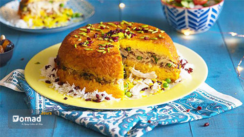 Tachin_A golden yellow rice with a crispy layer underneath with crimson juicy barberries, slices of almonds & pistachios