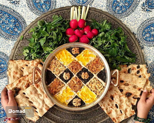 A Persian dish with eggplant served in a copper pot with Sangak bread & vegetables