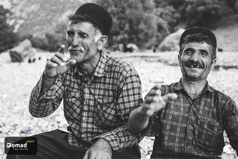 Two middle-age nomad brothers smiling broadly