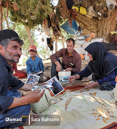 A nomad family is watching their own pictures