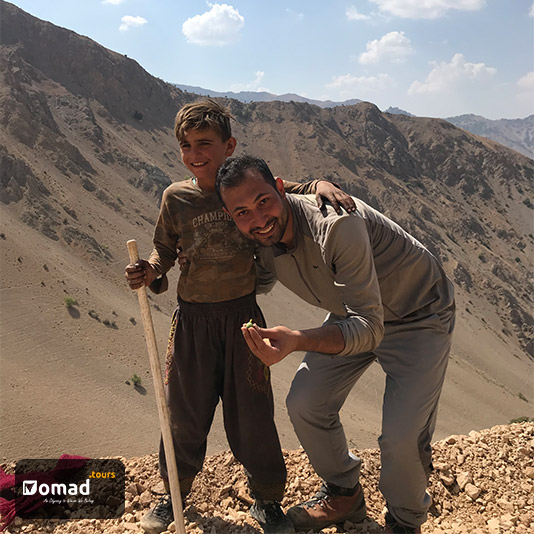 Kianoush, a nomad boy, and Muhammad with smiles on their lips